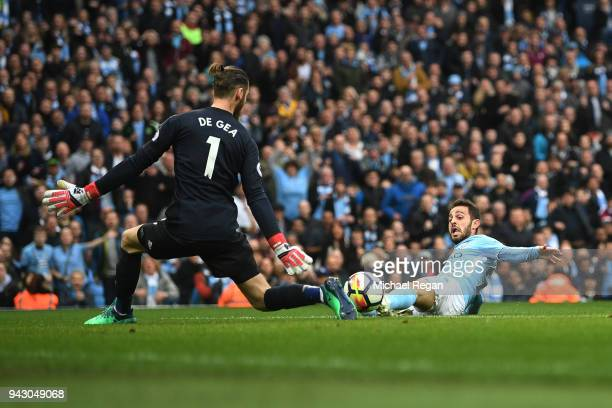 David De Gea of Manchester United saves a shot from Bernardo Silva of Manchester City during the Premier League match between Manchester City and...