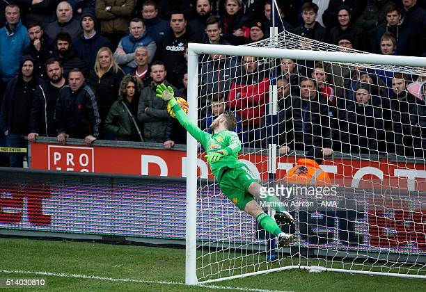 David de Gea of Manchester United saves a shot from Gareth McAuley of West Bromwich Albion during the Barclays Premier League match between West...