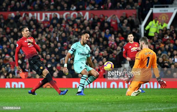 David De Gea of Manchester United saves a shot from PierreEmerick Aubameyang of Arsenal during the Premier League match between Manchester United and...