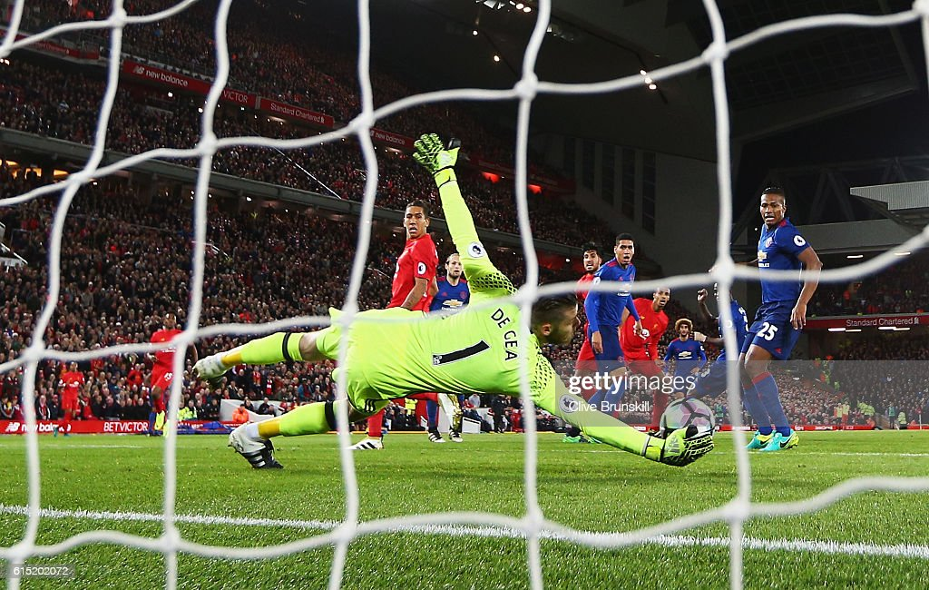 David De Gea of Manchester United saves from Emre Can of Liverpool during the Premier League match between Liverpool and Manchester United at Anfield on October 17, 2016 in Liverpool, England.
