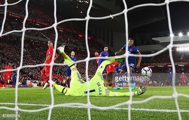 David De Gea of Manchester United saves from Emre Can of Liverpool during the Premier League match between Liverpool and Manchester United at Anfield...
