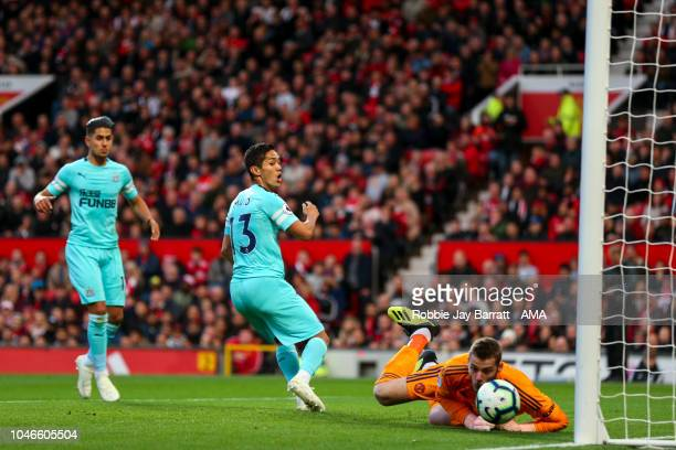 David de Gea of Manchester United saves from Yoshinori Muto of Newcastle United during the Premier League match between Manchester United and...