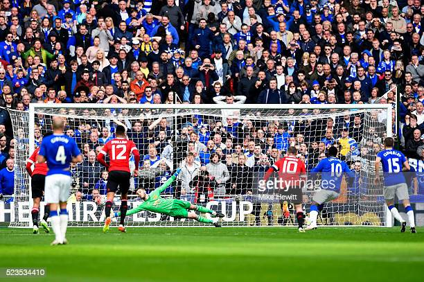 David De Gea of Manchester United saves Romelu Lukaku of Everton's penalty kick during The Emirates FA Cup semi final match between Everton and...