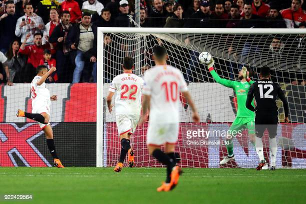 David De Gea of Manchester United saves the header of Luis Muriel of Sevilla FC during the UEFA Champions League Round of 16 First Leg match between...