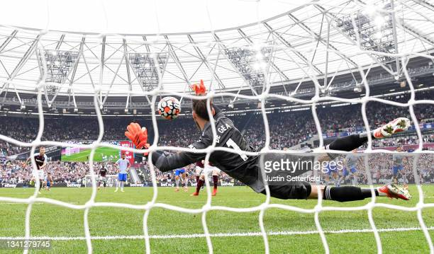 David De Gea of Manchester United saves the penalty taken by Mark Noble of West Ham United during the Premier League match between West Ham United...