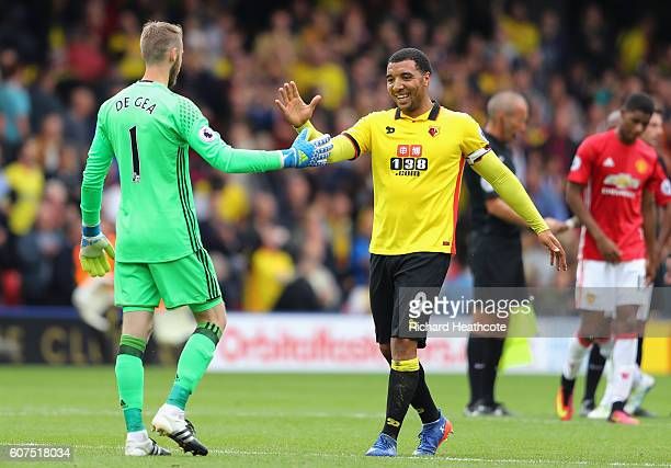 David De Gea of Manchester United shakes hands with Troy Deeney of Watford after the final whistle during the Premier League match between Watford...