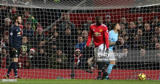 David de Gea of Manchester United shows his disappointment at conceding a goal to Nicolas Otamendi of Manchester City during the Premier League match...