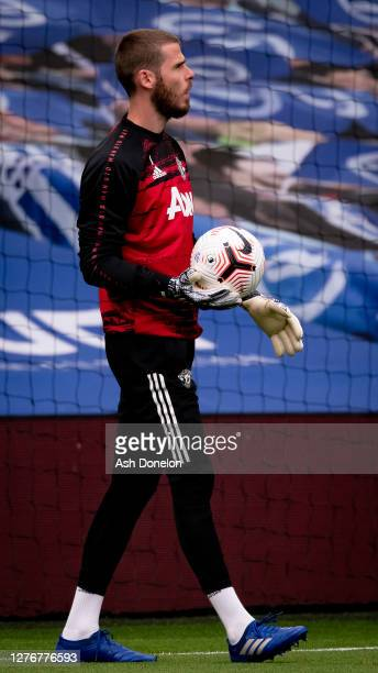 David de Gea of Manchester United warms up ahead of the Premier League match between Brighton Hove Albion and Manchester United at American Express...