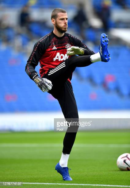 David De Gea of Manchester United warms up prior to the Premier League match between Brighton Hove Albion and Manchester United at American Express...