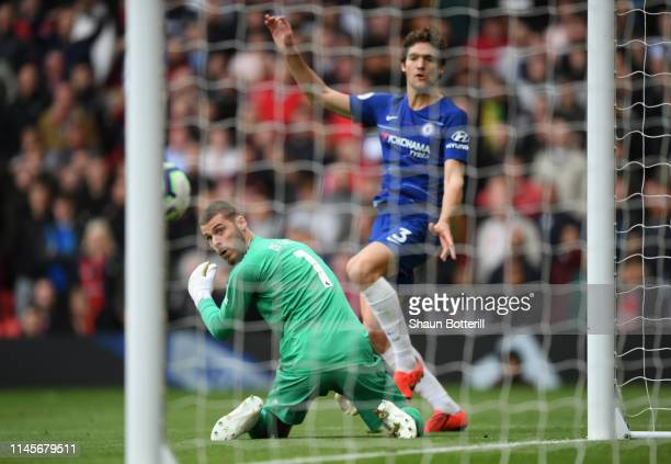 David De Gea of Manchester United watches the ball as Marcos Alonso of Chelsea scores during the Premier League match between Manchester United and...