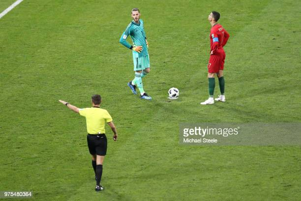 David De Gea of Spain and Cristiano Ronaldo of Portugal line up ahead of a penalty during the 2018 FIFA World Cup Russia group B match between...