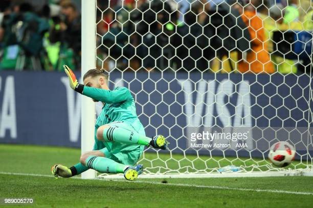 David De Gea of Spain fails to stop the penalty of Aleksandr Golovin of Russia during a penalty shootout during the 2018 FIFA World Cup Russia Round...