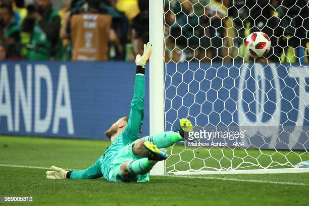 David De Gea of Spain fails to stop the penalty of Fedor Smolov of Russia during a penalty shootout during the 2018 FIFA World Cup Russia Round of 16...