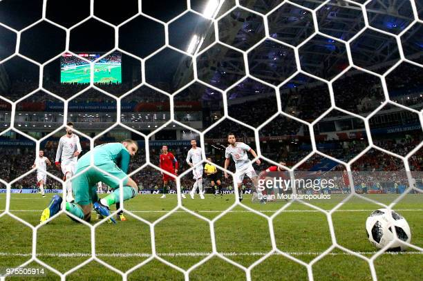 David De Gea of Spain is down on his knees as he makes a mistake as Cristiano Ronaldo of Portugal scores his sides second goal during the 2018 FIFA...