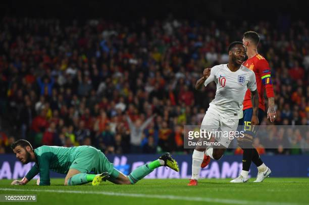 David de Gea of Spain looks dejected as Raheem Sterling of England celebrates after scoring his team's third goal during the UEFA Nations League A...