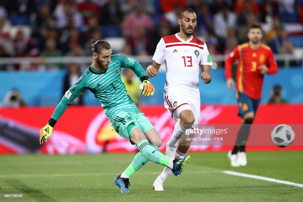 aaecc89504d David De Gea of Spain passes the ball under pressure from Khalid ...