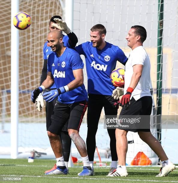David de Gea Sergio Romero and Lee Grant of Manchester United in action during a first team training session at Nad Al Sheba Sports Complex on...