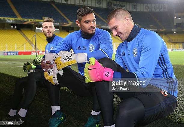 David de Gea Sergio Romero and Sam Johnstone of Manchester United in action during a first team training session at Sukru Saracoglu Stadium on...