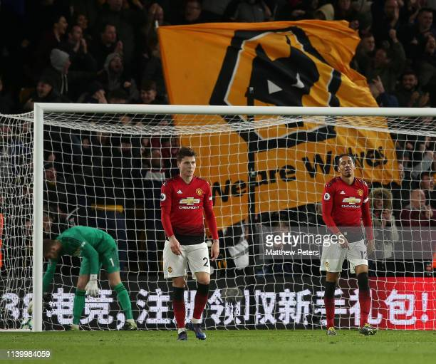 David de Gea Victor Lindelof and Chris Smalling of Manchester United react to conceding a goal to Leander Dendoncker of Wolverhampton Wanderers...
