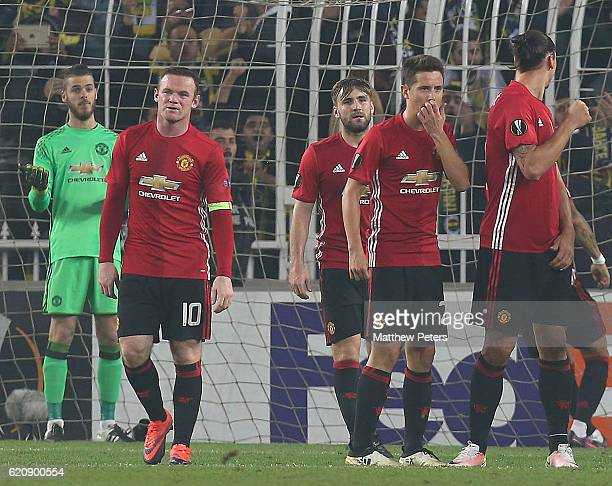 David de Gea Wayne Rooney Luke Shaw and Ander Herrera of Manchester United react to conceding a goal to Jermaine Lens of Fenerbahce during the UEFA...