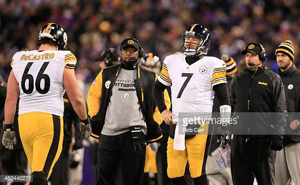 David DeCastro and Ben Roethlisberger stand next to head coach Mike Tomlin of the Pittsburgh Steelers after they failed to convert a two point...