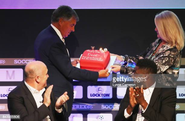 David Dein, The FA former Vice-Chairman is presented with a Birthday cake by Rita Revie, COO of Soccerex during day 3 of the Soccerex Global...