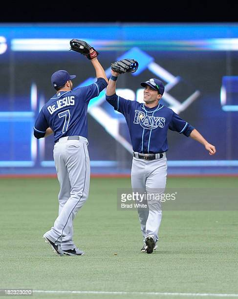 David DeJesus and Sam Fuld of the Tampa Bay Rays celebrate the teams win over the Toronto Blue Jays during MLB game action September 29 2013 at...