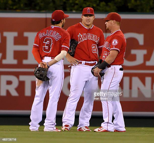 David DeJesus Mike Trout and Kole Calhoun of the Los Angeles Angels of Anaheim talk during the game against the Cleveland Indians at Angel Stadium of...