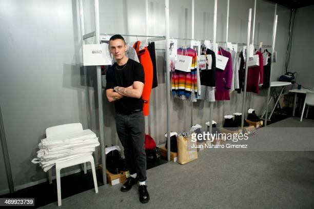 David Delfin prepares backstage before his fashion show during the Mercedes Benz Fashion Week Winter/Fall Madrid 2014 at Ifema on February 17 2014 in...