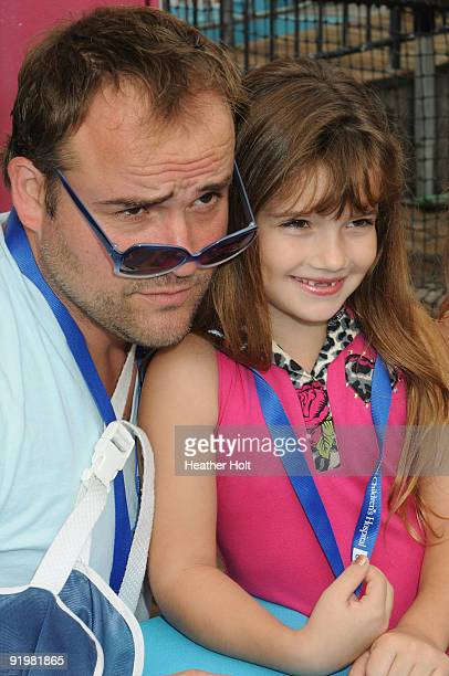 David Deluise poses with Alexis Burnett at the Mattel Party On The Pier on October 18 2009 in Santa Monica California