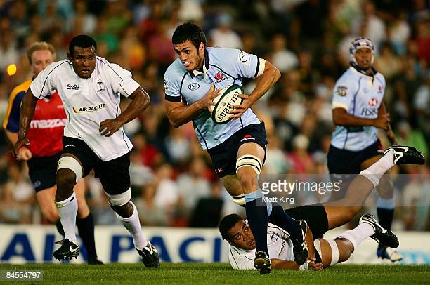 David Dennis of the Waratahs makes a break during the Super 14 preseason match between the New South Wales Waratahs and the Fiji Warriors held at...