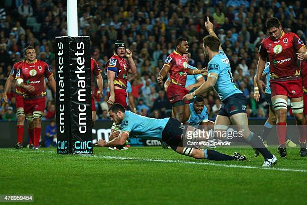 David Dennis of the Waratahs scores a try during the round 18 Super Rugby match between the Waratahs and the Reds at Allianz Stadium on June 13 2015...
