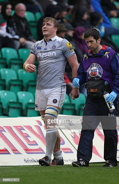David Denton of Bath is helped from the pitch during the Aviva Premiership match between Northampton Saints and Bath at Franklin's Gardens on...