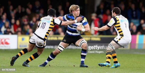 David Denton of Bath is tackled by Danny Cipriani and Alex Reider during the Aviva Premiership match between Bath and Wasps at the Recreation Ground...