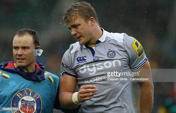 David Denton of Bath Rugby leaves the field injured during the Aviva Premiership match between Northampton Saints and Bath at Franklin's Gardens on...