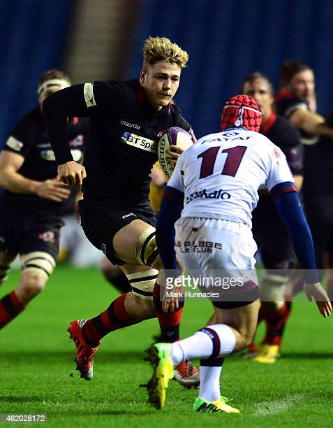 David Denton of Edinburgh Rugby is tackled by Paulin Riva of BordeauxBegles during the European Rugby Challenge Cup Pool 4 match between Edinburgh...