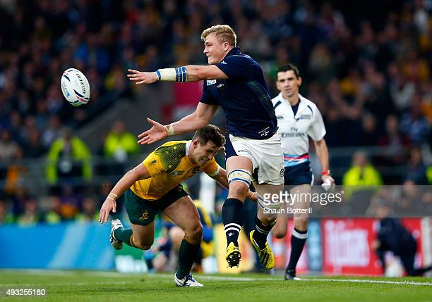 David Denton of Scotland offloads as he is tackled by Bernard Foley of Australia during the 2015 Rugby World Cup Quarter Final match between...