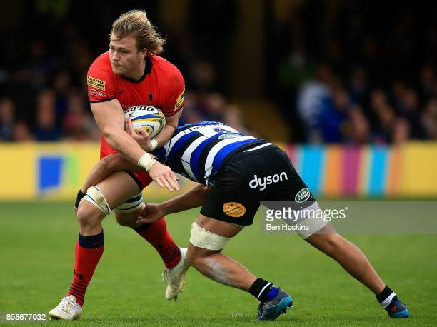 David Denton of Worcester is tackled by Taulupe Faletau of Bath during the Aviva Premiership match between Bath Rugby and Worcester Warriors at...