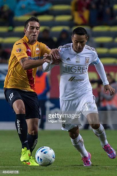David Depetris of Morelia fights for the ball with Juninho of Tigres during a match between Morelia and Tigres UANL as part of 6th round Apertura...