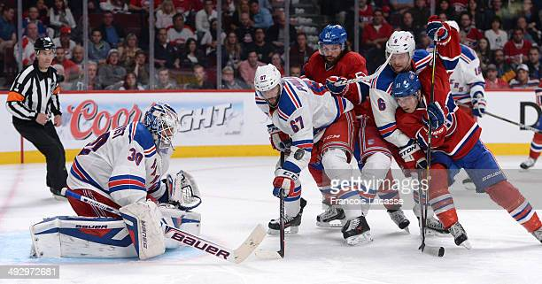 David Desharnais and Brendan Gallagher of the Montreal Canadiens fight for the puck against Benoit Pouliot and Anton Stralman of the New York Rangers...