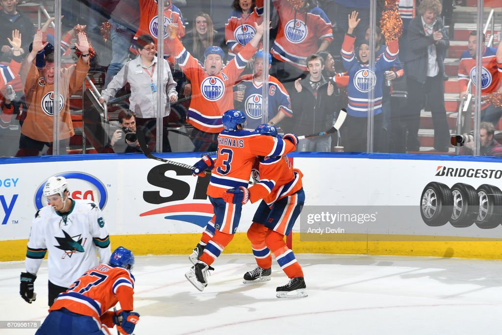 David Desharnais #13 and Leon Draisaitl #29 of the Edmonton Oilers celebrate after winning Game Five of the Western Conference First Round during the 2017 NHL Stanley Cup Playoffs against the San Jose Sharks on April 20, 2017 at Rogers Place in Edmonton, Alberta, Canada.