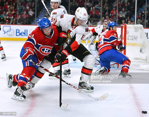 David Desharnais of the Montreal Canadiens and Peter Regin of the Ottawa Senators battles for the puck during the NHL game on February 3, 2013 at the...