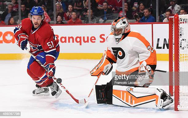 David Desharnais of the Montreal Canadiens attempts to deflect the puck against Ray Emery of the Philadelphia Flyers in the NHL game at the Bell...