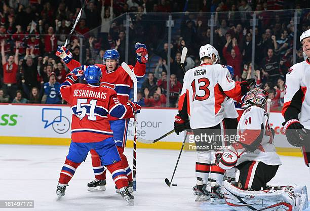 David Desharnais of the Montreal Canadiens celebrates his first period goal with teammate Erik Cole during the NHL game against the Ottawa Senators...