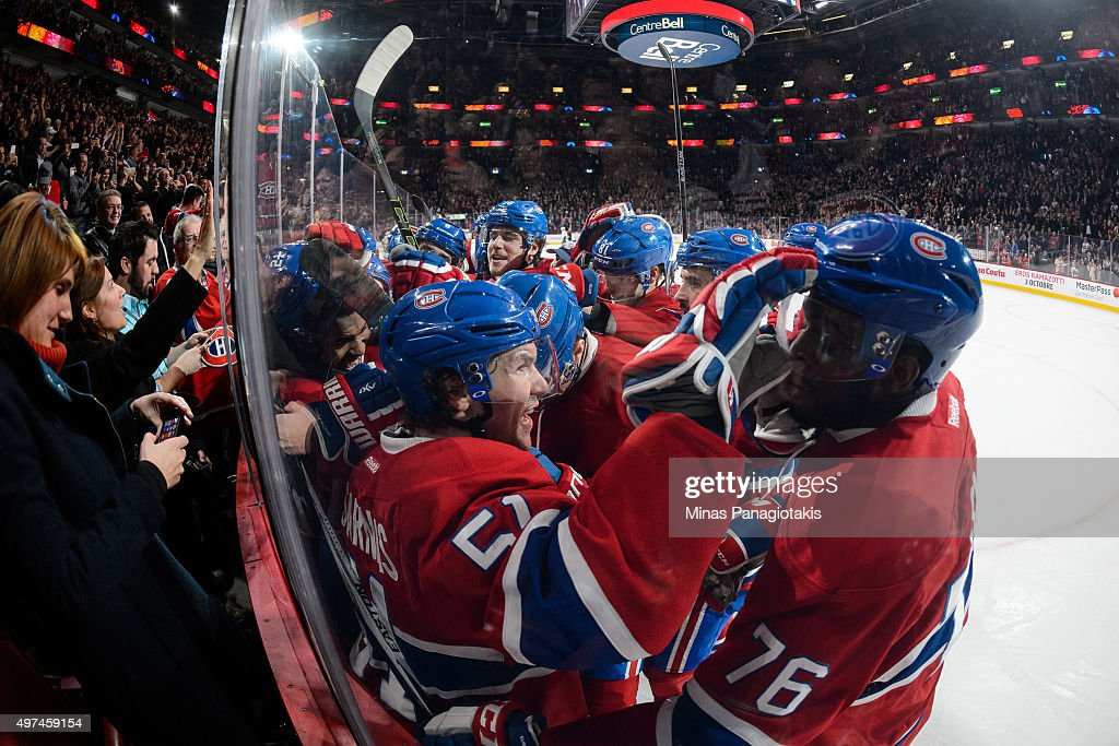 David Desharnais #51 of the Montreal Canadiens celebrates his overtime goal with teammates during the NHL game against the Vancouver Canucks at the Bell Centre on November 16, 2015 in Montreal, Quebec, Canada. The Montreal Canadiens defeated the Vancouver Canucks 4-3 in overtime.
