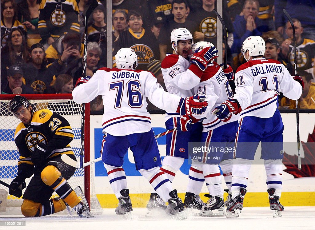 David Desharnais #51 of the Montreal Canadiens celebrates scoring the winning goal in the third period with teammates Max Pacioretty #67, P.K. Subban #76, and Brendan Gallagher #11 against the Boston Bruins during a game at the TD Garden on March 3, 2013 in Boston, Massachusetts. The Montreal Canadiens defeated the Boston Bruins 4-3.