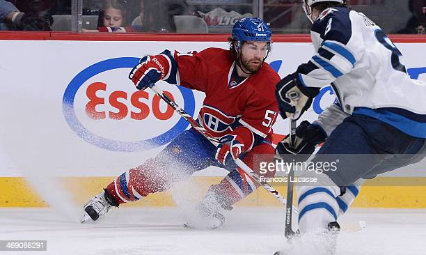 David Desharnais of the Montreal Canadiens controls the puck against the Winnipeg Jets during the NHL game on February 2 2014 at the Bell Centre in...
