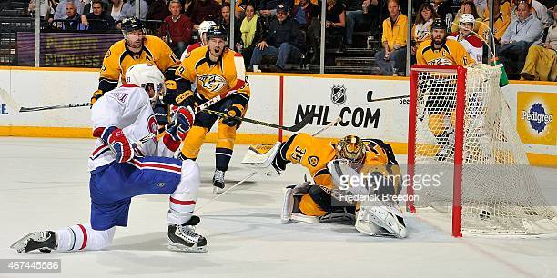 David Desharnais of the Montreal Canadiens scores a goal against goalie Pekka Rinne of the Nashville Predators during the second period at...