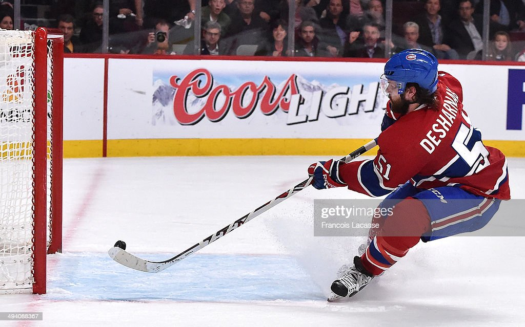David Desharnais #51 of the Montreal Canadiens scores a goal on the empty net of the New York Rangers in Game Five of the Eastern Conference Final during the 2014 NHL Stanley Cup Playoffs at the Bell Centre on May 27, 2014 in Montreal, Quebec, Canada.