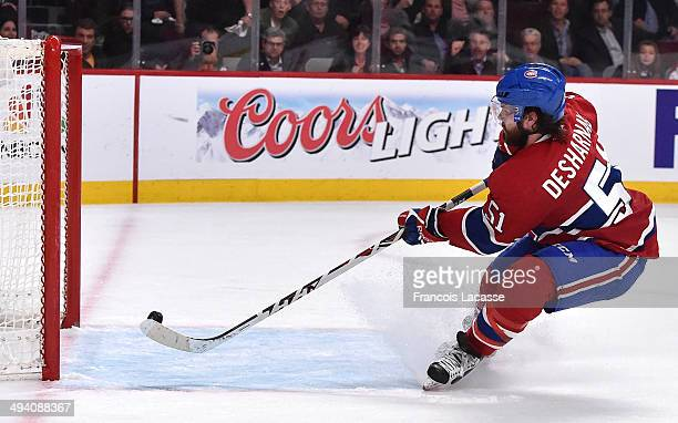 David Desharnais of the Montreal Canadiens scores a goal on the empty net of the New York Rangers in Game Five of the Eastern Conference Final during...